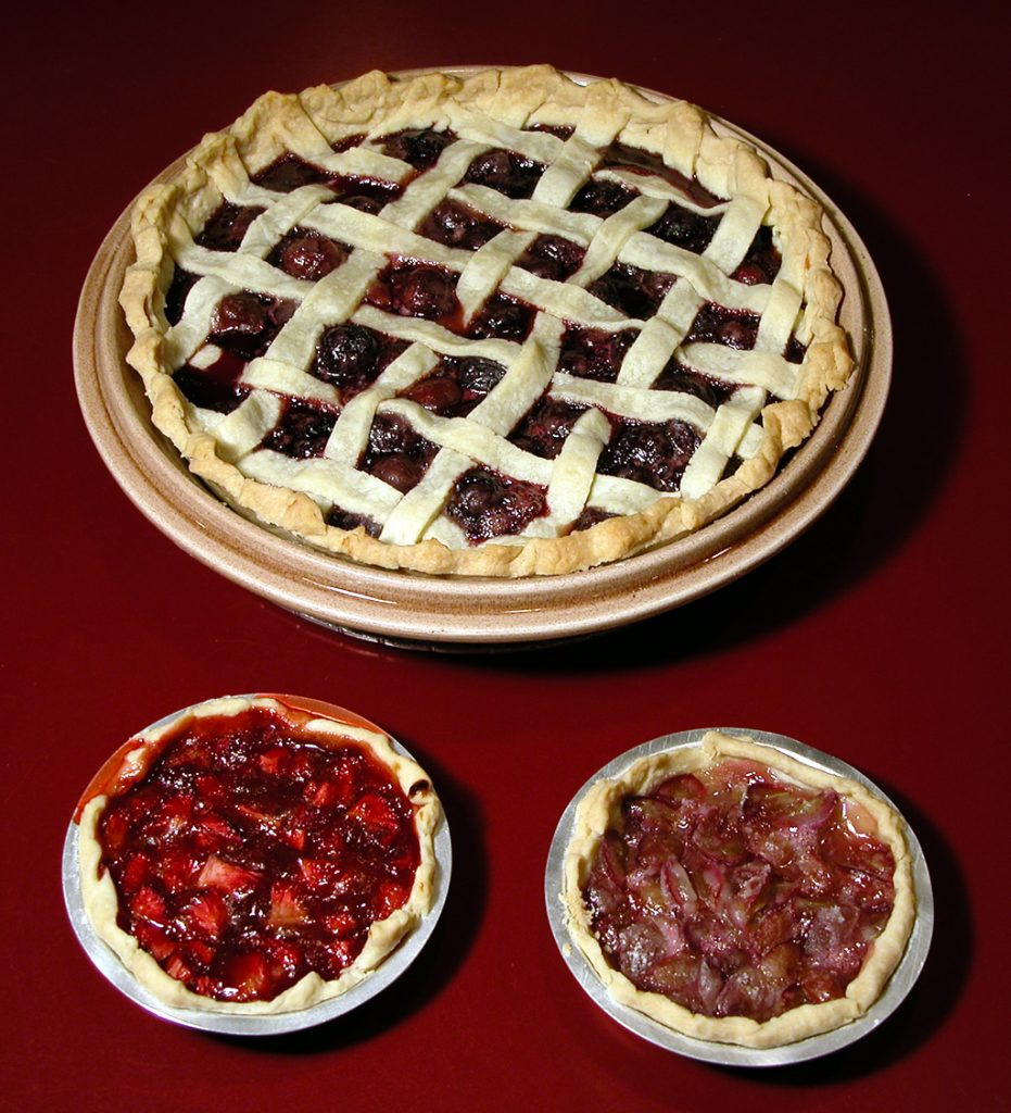 Strawberry pie with lattice top crust & two small tarts